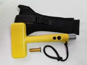 Shown with the carrying holster and detection standard.